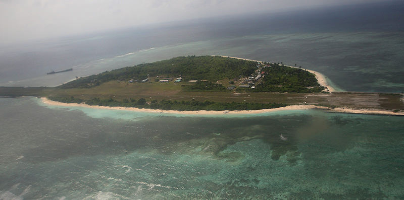 A file picture dated 20 July 2011 and taken through the window of a closed aircraft, shows an aerial view of Pagasa Island, part of the disputed Spratly group of islands, in the South China Sea (EPA Photo)