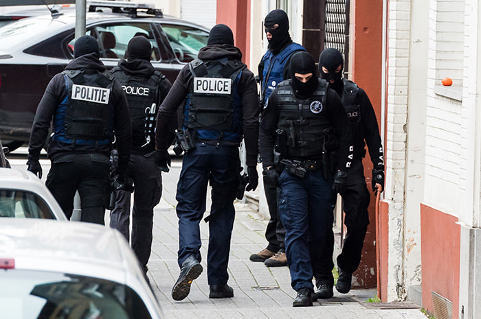 In this Monday, Nov. 16, 2015 file photo, armed police guard a street in Brussels (AP Photo)