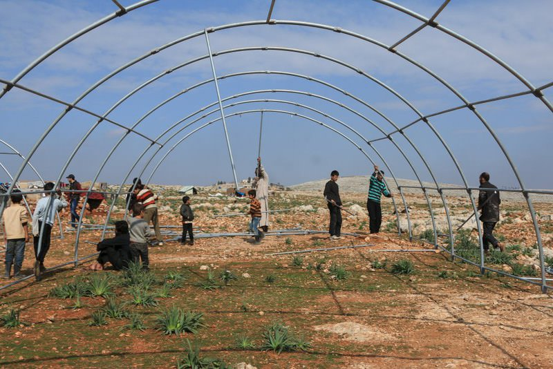 Internally displaced Syrians who fled from Aleppo, are constructing a tent inside a refugee camp in the village of Batabo, northern Idlib countryside, Syria.
