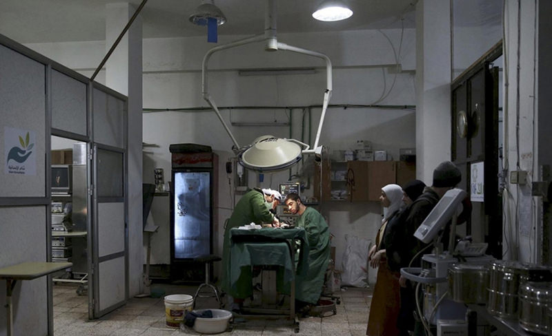Medics in Douma area treating the injured in basements and other improvised shelters (Reuters Photo)