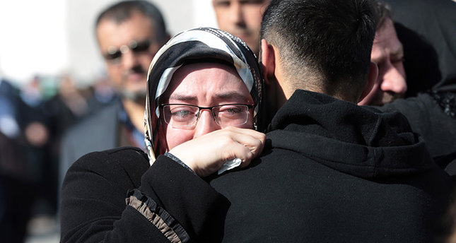 Family members of victims comfort each other outside the medical forensics site in Ankara, Turkey , Feb. 18, 2016 AP