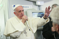 In this photo taken Wednesday, Feb. 17, 2016 Pope Francis meets journalists aboard the plane during the flight from Ciudad Juarez, Mexico to Rome, Italy. (AP Photo)