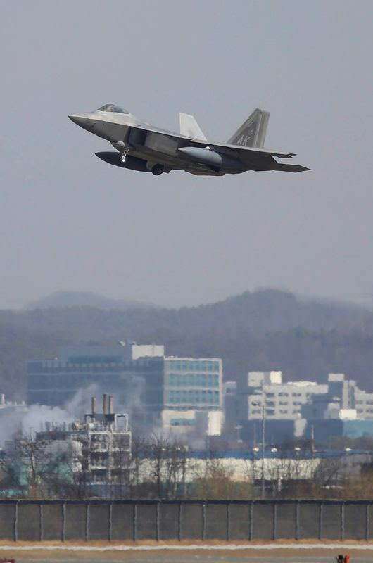 One of the four US Air Force F-22 Raptors, deployed by the US military, flies over Osan Air Base, south of Seoul, South Korea.