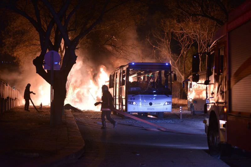 Firefighters trying to extinguish flames following an explosion after a terror attack by the YPG targeted a convoy of military vehicles in Ankara, killing 28 people.