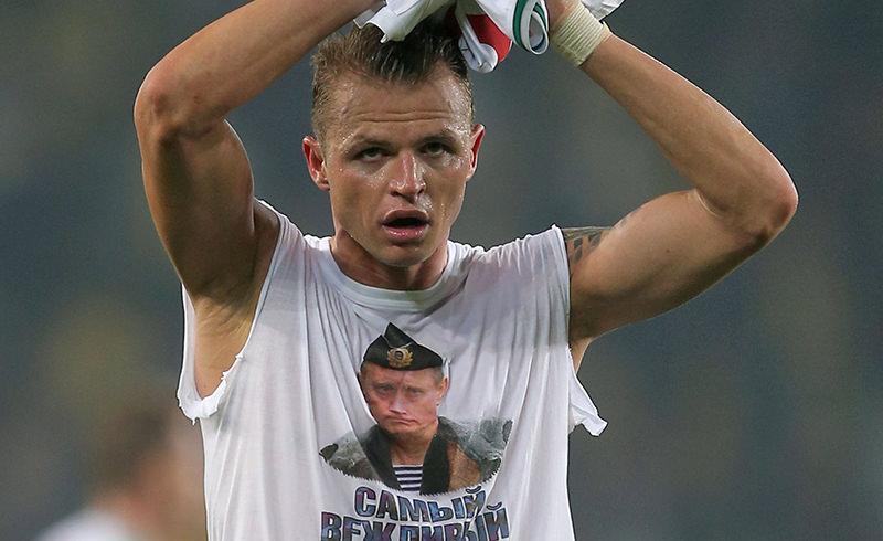Lokomotiv Moscow's Dmitri Tarasov wears a shirt showing Russian President Vladimir Putin that reads 'Most polite president' (AFP Photo)
