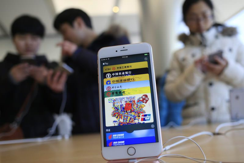 The Apple Pay app running on an iPhone at an Apple Store in Beijing, China.