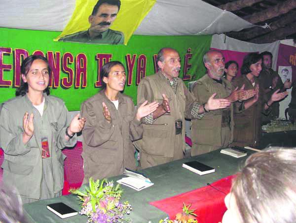 PYD militant Şilan Kobani (2nd L) with senior PKK leader Duran Kalkan (CL),