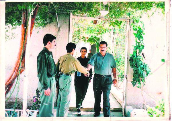 PYD militant Şilan Kobani (CR) with seen next to the imprisoned PKK leader Abdullah Öcalan (R).