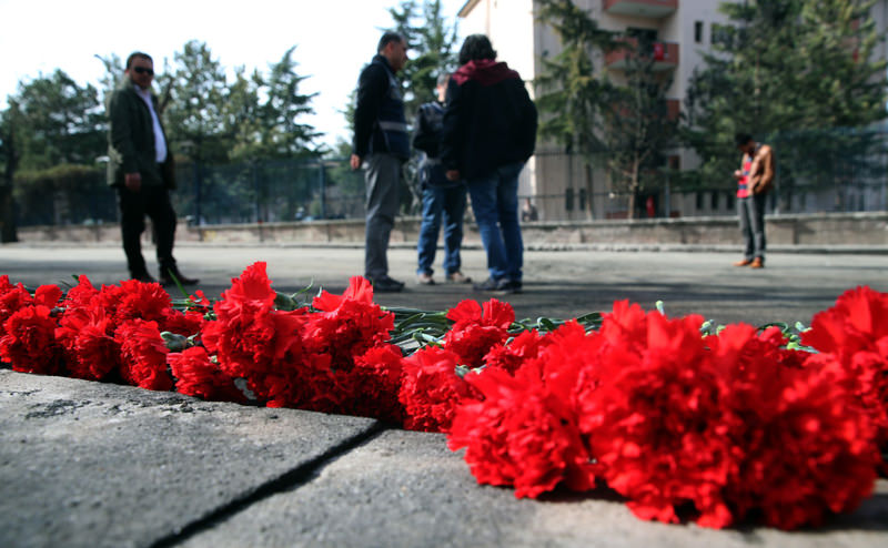 Carnations are left at the explosion site for the victims of Wednesday's suicide bomb attack by the YPG in Ankara. (AP Photo)