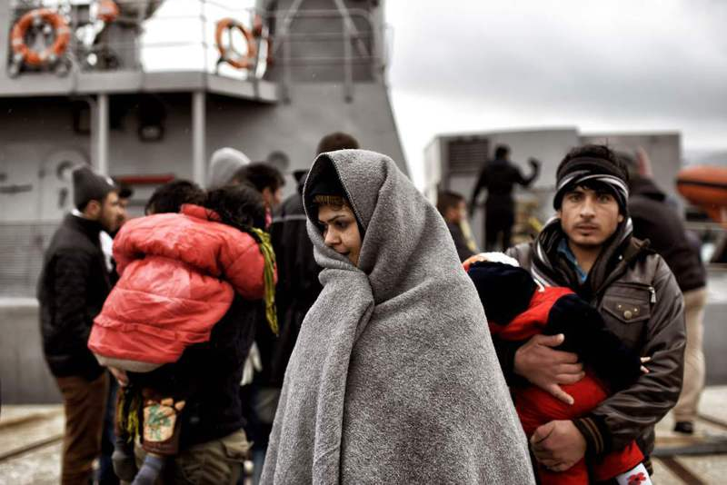 Migrants rescued by the Greek coast guard disembark from a ship upon their arrival to Mytilene on the northern island of Lesbos after crossing the Aegean Sea on Feb. 19. (AFP Photo)
