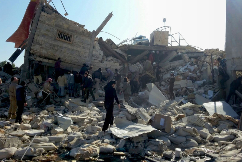 Syrians gathering outside a hospital supported by Doctors Without Borders in Syria's northern province of Idlib on Feb. 16, after the building was hit by suspected Russian airstrikes the previous day. (AFP Photo)