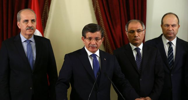 Turkish Prime Minister Ahmet Davutoglu C speaks to the press after a security meeting in the governor's office in Ankara on February 20, 2016. AFP Photo