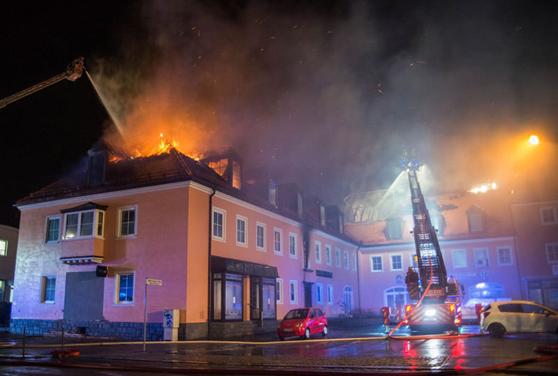 Fire fighters extinguish flames at a former hotel in Bautzen, Germany, where a fire broke out overnight 21 February 2016. (EPA)