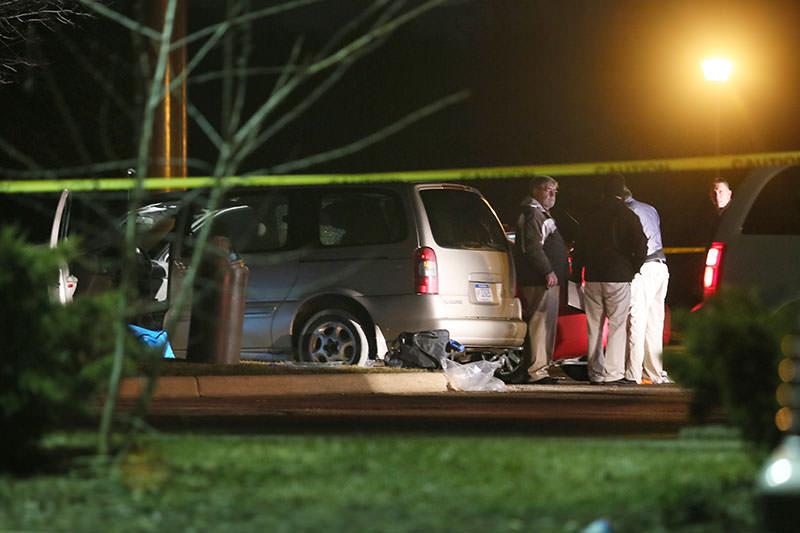 Police investigate the scene early Feb. 21, 2016, where people were shot in vehicles outside Cracker Barrel restaurant in Kalamazoo, Mich. (Mark Bugnaski/Kalamazoo Gazette)