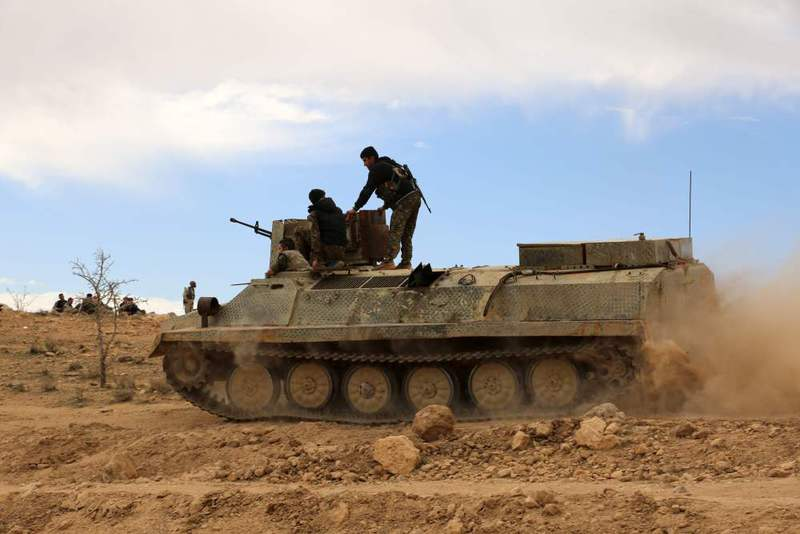 Fighters from the Syrian Democratic Forces (SDF) siting atop an armoured personnel carrier on the outskirts of the town of Chaddade in the northeastern Syrian province of Hasaka.