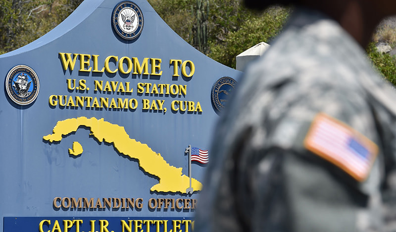 his file photo taken on April 7, 2014 shows a photo reviewed by the US military and made during an escorted visit, of a welcome board at the road to the US Naval Station in Guantanamo Bay (AFP Photo)