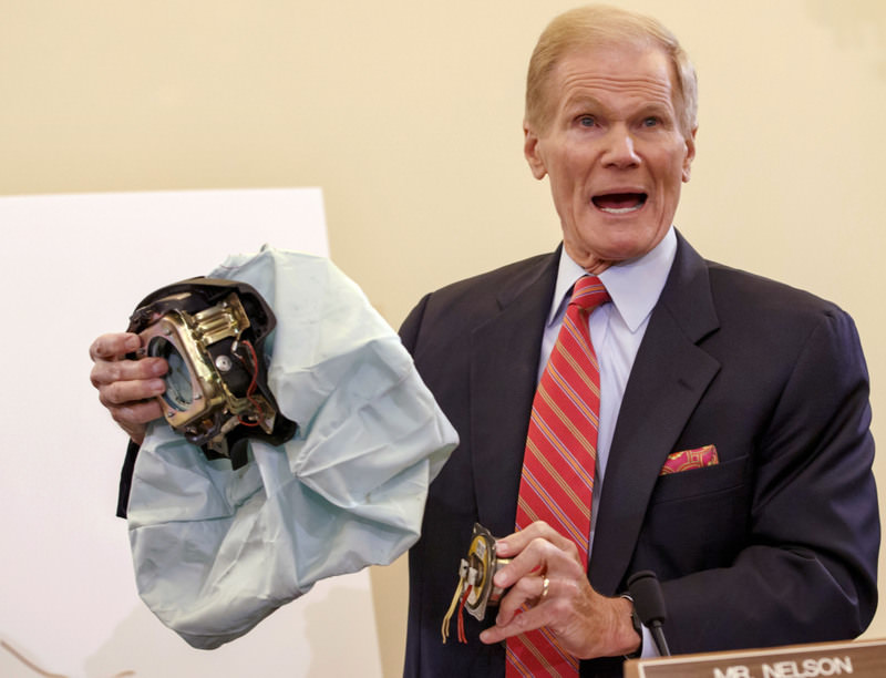 In this Nov. 20, 2014, file photo, U.S. Senate Commerce Committee member Bill Nelson, D-Florida. holds an example of the defective airbag made by Japan's Takata