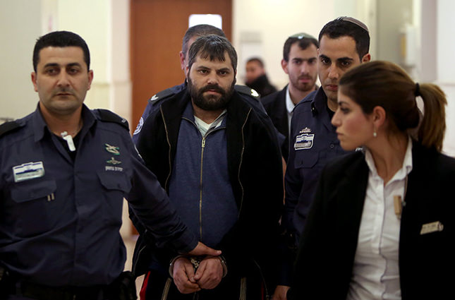Yosef Haim Ben-David (2L) who is the prime suspect charged with the abduction and murder of the Palestinian teenager Mohammed Abu Khdeir. February 11, 2016 (AFP Photo)