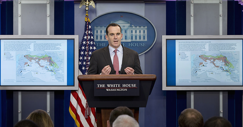 Flanked by maps of Iraq and Syria,u00a0Brettu00a0McGurk, speaks during the daily news briefing at the White House in Washington (AP Photo)