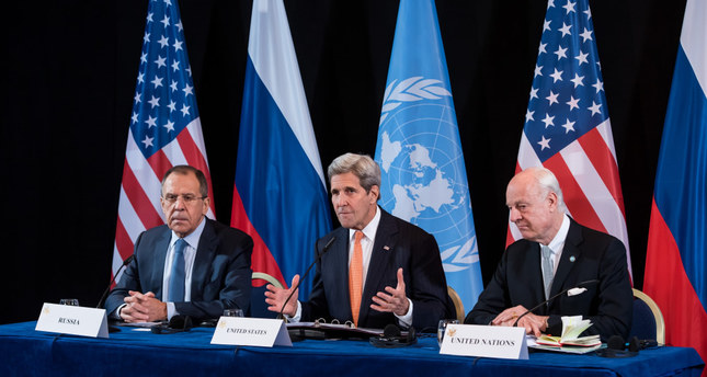 Russian FM Lavrov (L) and U.S. Secretary of State Kerry hold a press conference after the International Syria Support Group (ISSG) meeting in Munich on Feb. 11.
