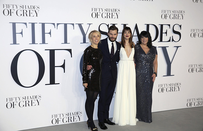 (L-R) Director of the film Sam Taylor-Johnson, cast members Jamie Dornan, Dakota Johnson and author E. L. James at the British premiere of the movie 'Fifty Shades of Grey', February 12, 2015 (Reuters Photo)