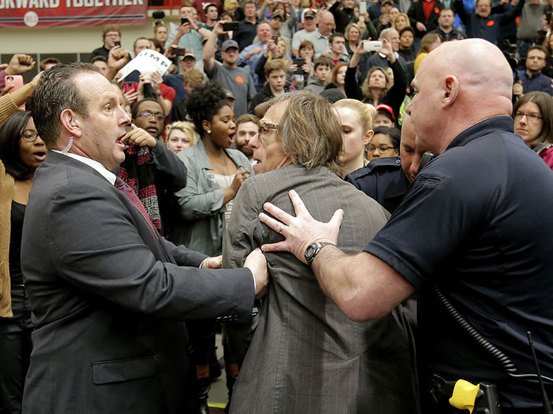 Photographer Christopher Morris is removed by security officials as Trump speaks during a campaign event in Virginia Feb 29, 2016 (Reuters)