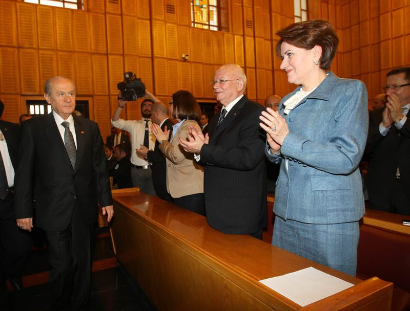 In this file photo from 2012, MHP Chairman Bahu00e7eli (L) and then MHP Deputy Aku015fener (R) are seen in a parliamentary group meeting. Aku015fener is accused of being affiliated with the Gu00fclen Movement.