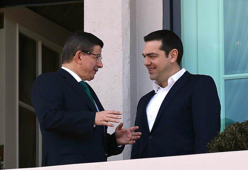 Prime Minister Ahmet Davutou011flu (L) and Greek Prime Minister Alexis Tsipras