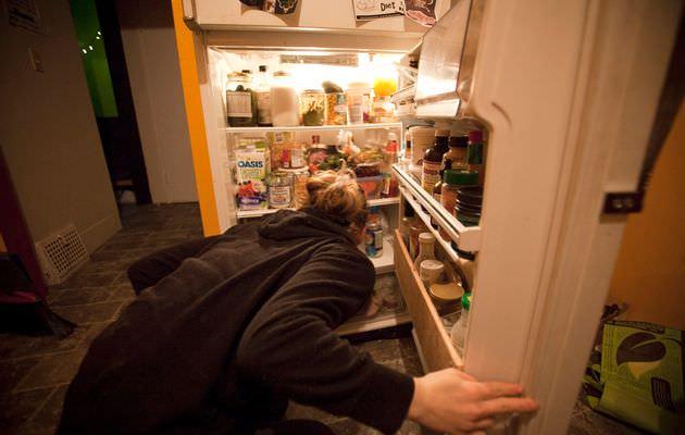 A woman looks through her fridge. (REUTERS Photo)