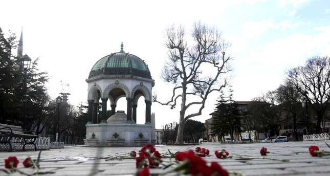 Carnations laid on the ground of Sultanahmet Square near the blast site, with the German Fountain seen in the background. (FILE Photo)