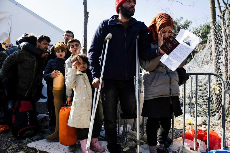 Refugees including a disabled man, have been waiting for days to cross the Macedonian border.