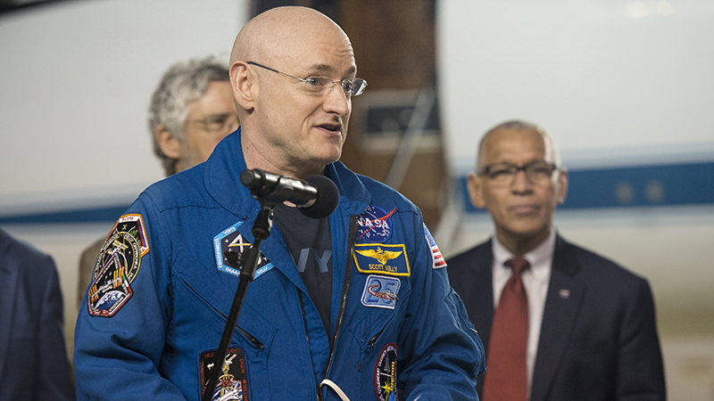 A handout photo made available by NASA, showing Expedition 46 Commander Scott Kelly of NASA delivering remarks after arriving at Ellington Field, 03 March 2016 in Houston, Texas (EPA Photo)