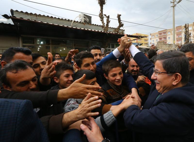 Locals greet PM Davutou011flu in u015eu0131rnak's Silopi district on Friday. (AA Photo)
