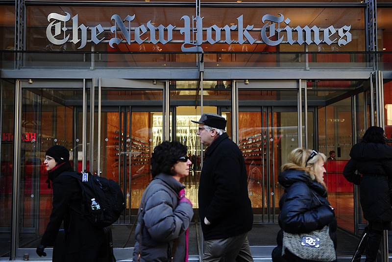 People walk by the entrance to US newspaper 'The New York Times' in New York, in this March 8, 2011 (AFP Photo)