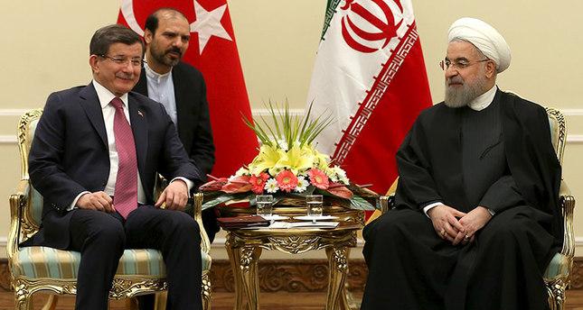 Iranian President Hassan Rouhani (R) meets Turkish Prime Minister Ahmet Davutoglu in Tehran, Iran March 5, 2016 (Reuters Photo)