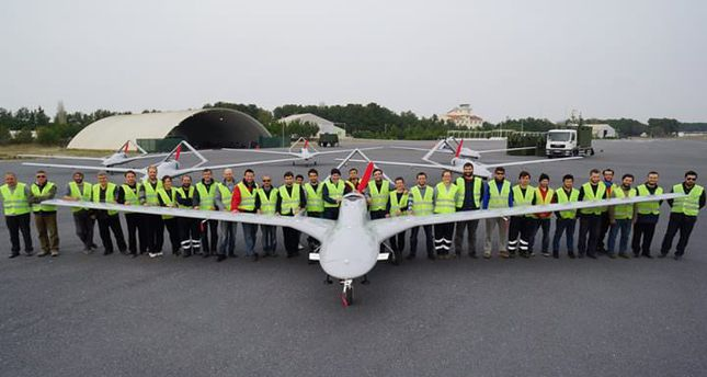 The team which manufactured Bayraktar TB2 posing at the production center