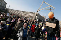 Protester holds a symbolic gibbet with an effigy of Putin and plate on it breast reading like 'Killer' during their rally in downtown Kiev, Ukraine, 06 March 2016 (EPA).