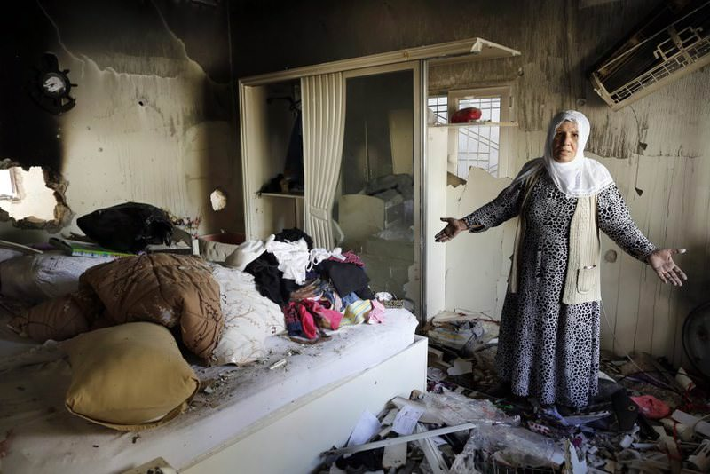 A Kurdish woman standing amid the rubble of her destroyed house, the day after clashes between the Turkish security forces and PKK militants in Cizre district of southeastern u015eu0131rnak province, Turkey.