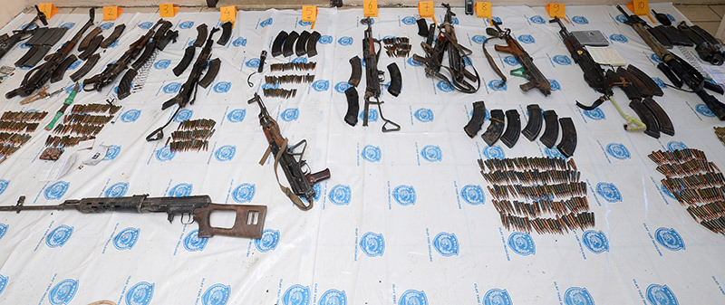 Weapons and ammunition belonging to PKK terrorists confiscated by Turkish security officials (AA Photo)