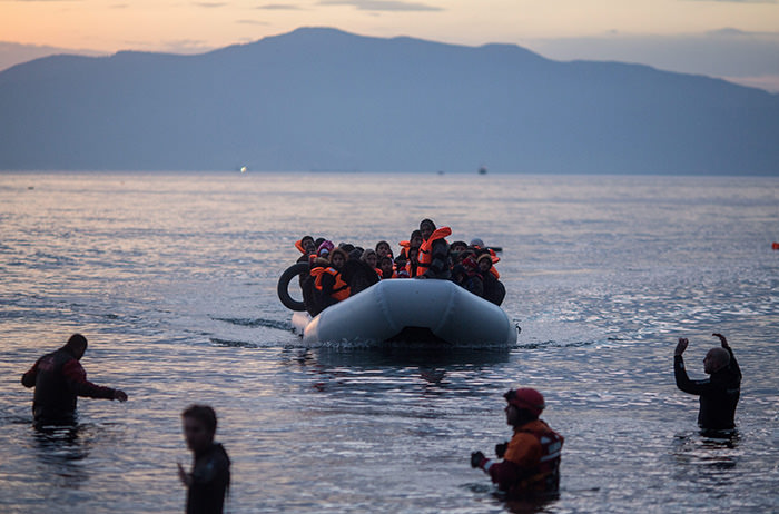 efugees arrive on a rubber boat from Turkey on the Greek island of Lesbos, near the port city of Mytilene, Greece, 09 March 2016 (EPA Photo)