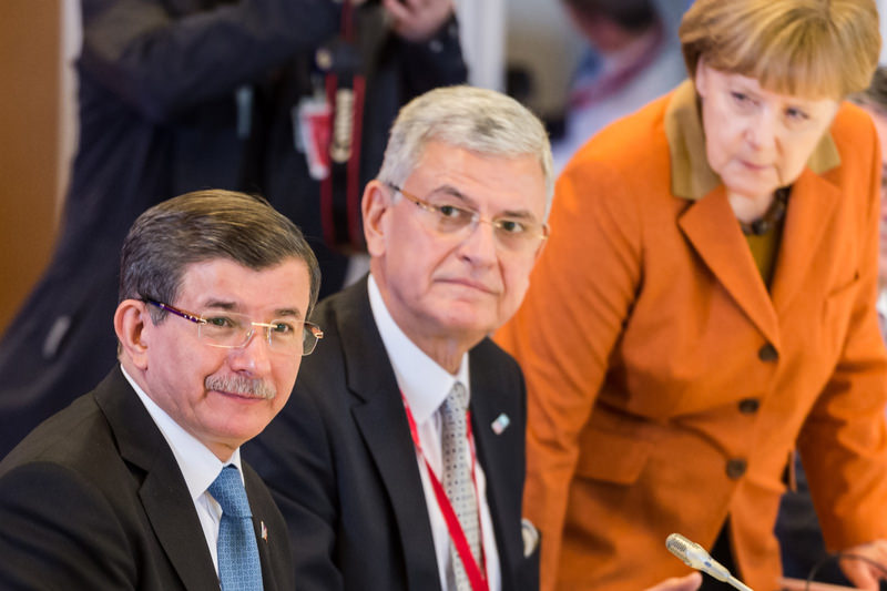 PM Davutou011flu (L) with German Chancellor Merkel (R) during a special Turkish-EU summit in Brussels on Monday.