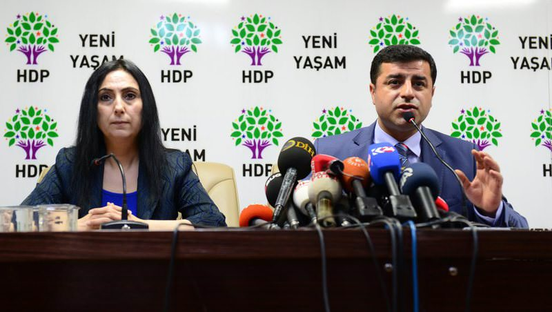HDP Co-Chairs Yu00fcksekdau011f (L) and Demirtau015f at a press conference. The two deputies could face lawsuits if Parliament lifts their immunities on March 22.
