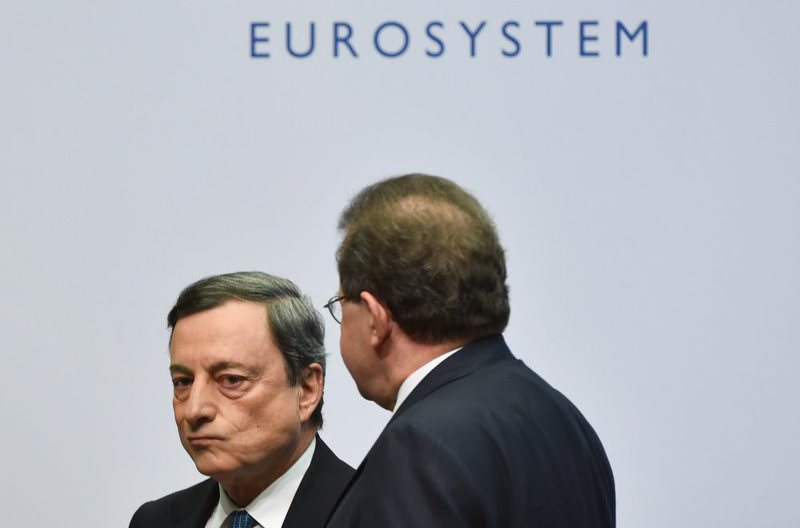 Mario Draghi (L), president of the European Central Bank (ECB), and vice president Vitor Constancio leave after an ECB press conference in Frankfurt, Germany, yesterday.