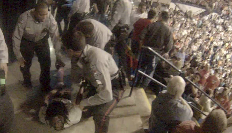 Rakeem Jones lies on the ground while being removed by deputies from a Donald Trump rally in Fayetteville, North Carolina March 9, 2016, in a still image from video provided by Ronnie Rouse March 10, 2016 (Reuters Photo)