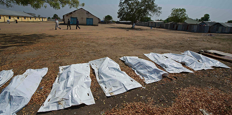 This file photo taken on January 27, 2014 shows sheets covering the bodies of 16 people, allegedly civilians killed when they took cover near Leudit church in Bor town, according to the South Sudanese military. (AFP Photo)