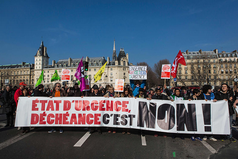 Protestors hold a banner during a demonstration against the state of emergency in France called by the C ollective Against Islamophobia in France (AFP)