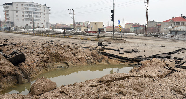 A near 5-meter-wide crater, which formed as handmade explosives laid under a street in were detonated during the passage of a military convoy, is seen in Yüksekova town center on March 12, 2016. (AA Photo)