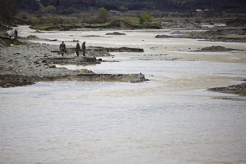Macedonian soldiers scout for bodies of drowned refugees on the river bank of Suva Reka river near the southern Macedonian town of Gevgelija, March 14, 2016. (AP)