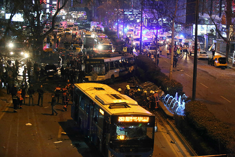 Police, firefighters and emergency services work at the site of a blast in Ankara on March 13, 2016. (AFP)