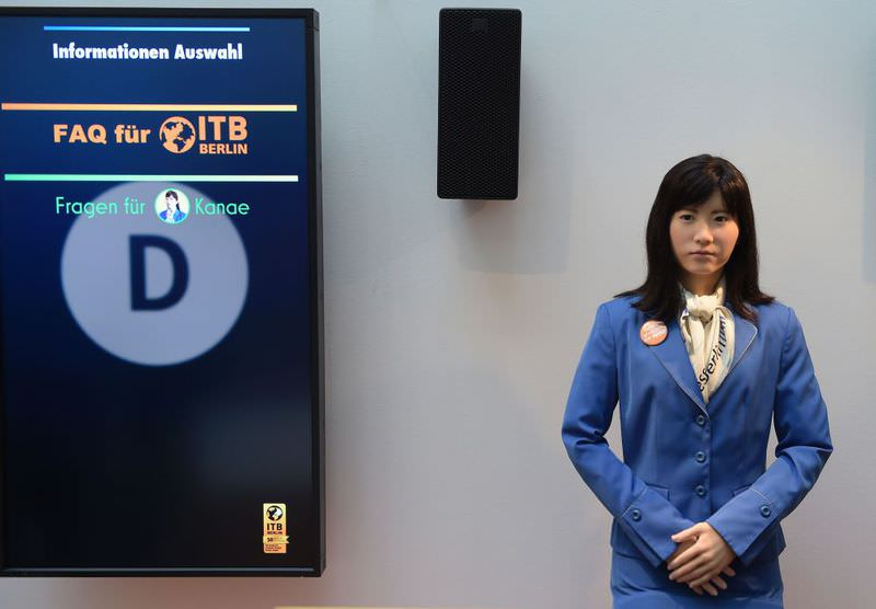 Robot Chihira Kanae, developed by Toshiba, is pictured at a welcome desk at the International Tourism Fair ITB in Berlin.